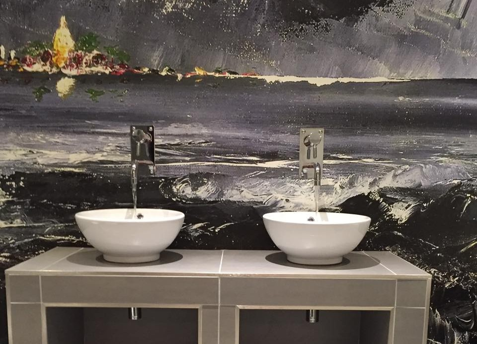 Abstract mural backdrop with sinks